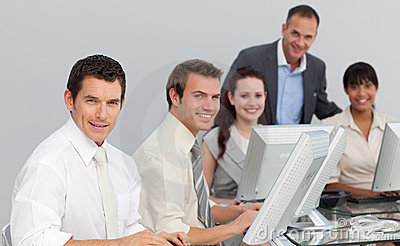 Business team working with computers in an office