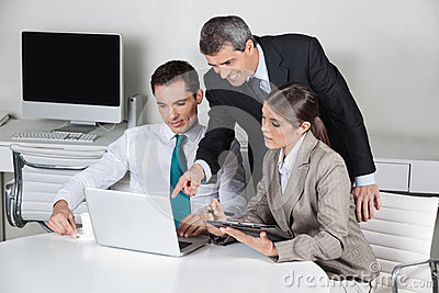 Business team working on laptop