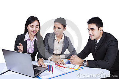 Business team working with laptop - isolated