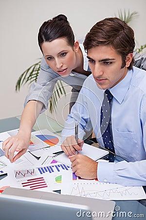Business team working on statistics together