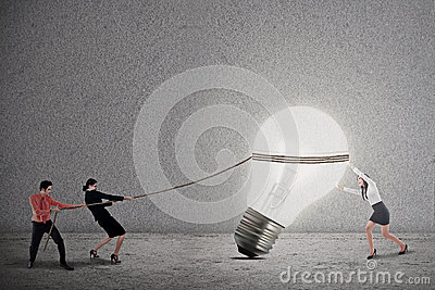 Business teamwork pull light bulb
