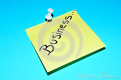 Business text on sticky note