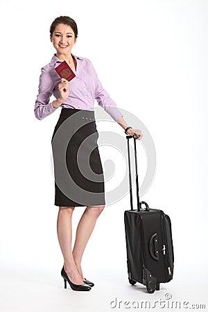 Business travel woman holding british passport