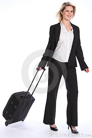 Business travel young happy blonde woman with case