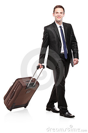 Business traveler carrying a suitcase