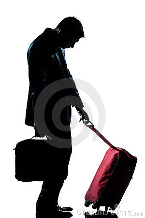 Business traveler man tired with suitcase