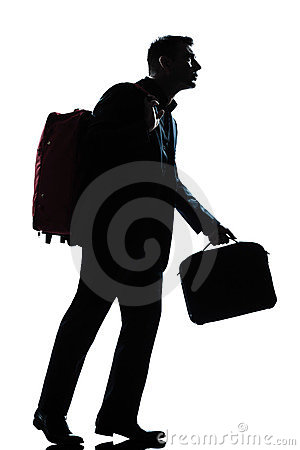 Business traveler man walking with suitcase
