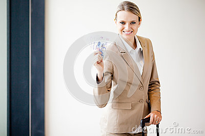 Business traveller holding money