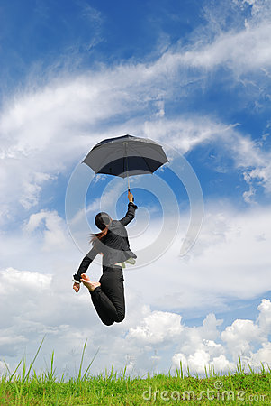 Business umbrella woman jumping  blue sky