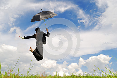 Business umbrella woman jumping to blue sky
