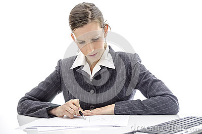 Business woman analyzing documents