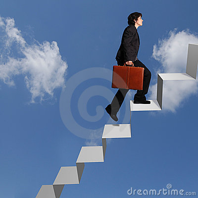 Business woman ascending stairs