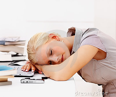 Business woman asleep at work
