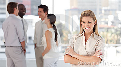 Business woman with associates smiling