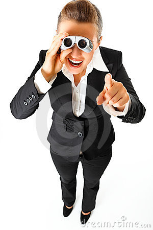 Business woman with binoculars pointing finger