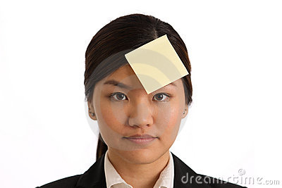 Business woman with a blank post-it note on head