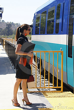 Business Woman Boarding Train