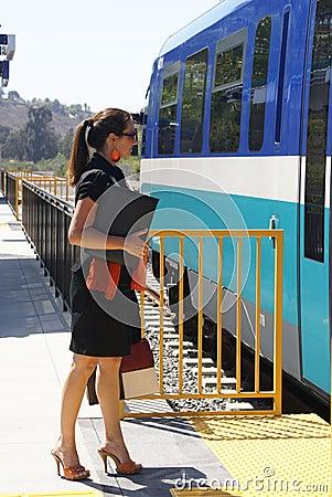 Business Woman Boarding Train