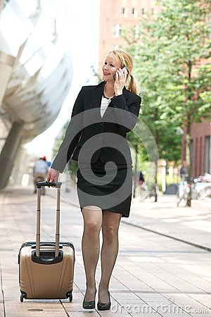 Business woman calling on cellphone in the city