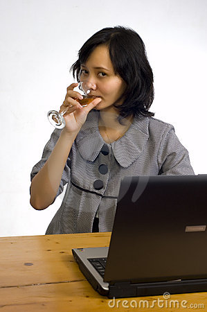 Business Woman Celebrating Her Success with Wine