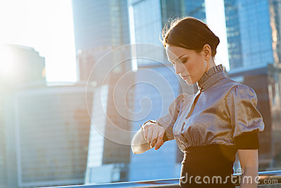 Business woman checking the time