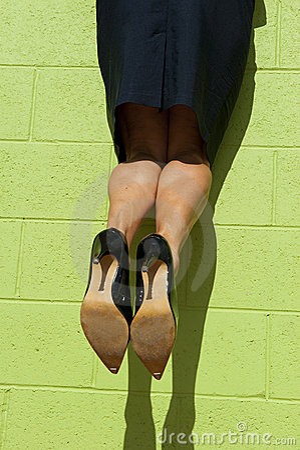 Business Woman Climbing Up a Wall