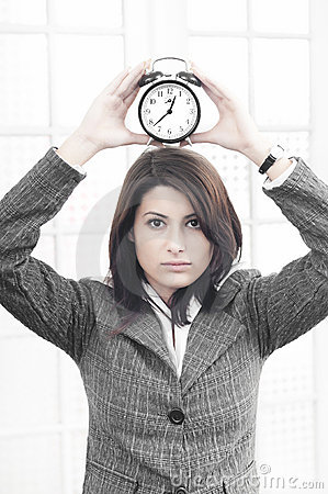 Business woman with a clock