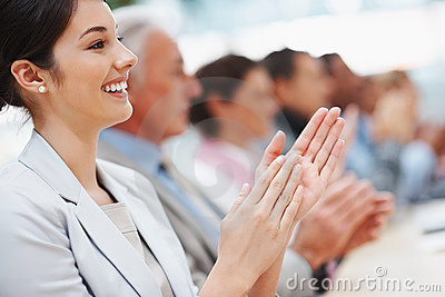 Business woman with colleagues applauding