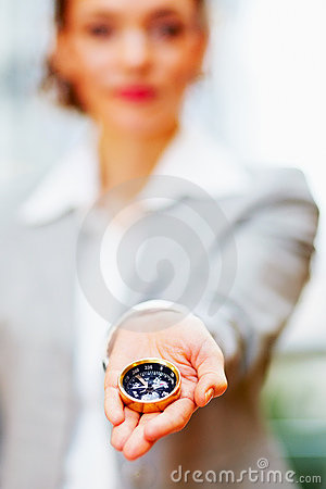 Business woman with a compass