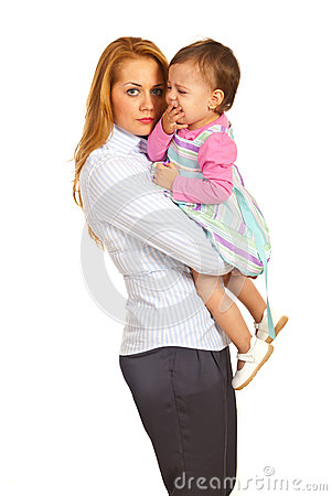 Business woman with crying toddler girl