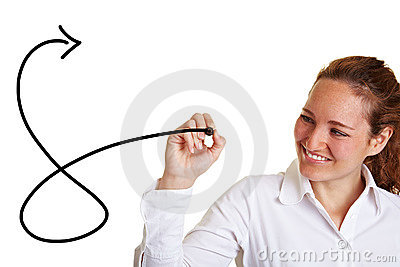 Business woman drawing an arrow