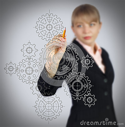 Business woman drawing gears on screen