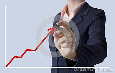 Business woman drawing a graph on screen