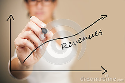 Business woman drawing a revenue graph