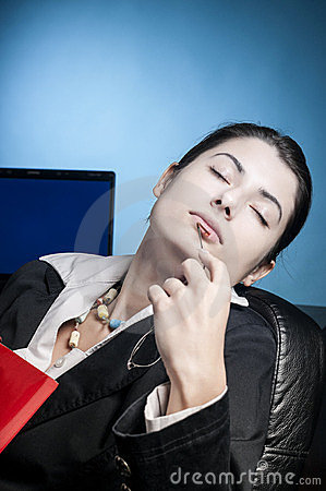 Business woman dreaming with a file in her hand