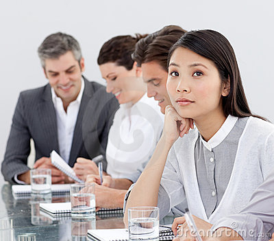 A business woman is dreaming in a meeting