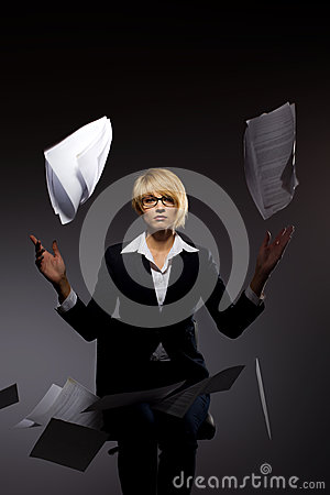 Business woman dropping heap of paper