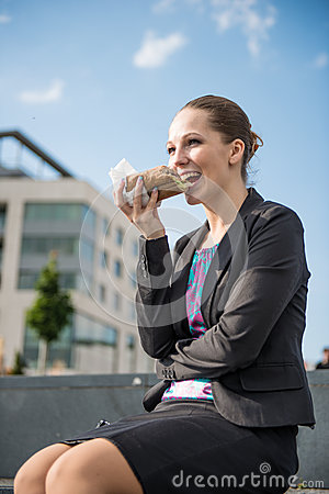 Business woman eating- break �