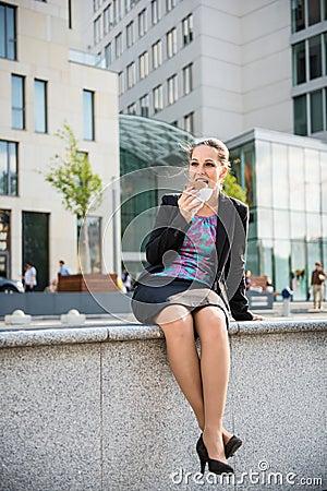 Business woman eating- break �