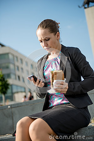 Business woman eating - problems