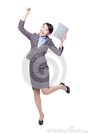Business woman excited with tablet pc
