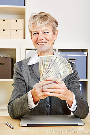 Business woman with fan of dollar