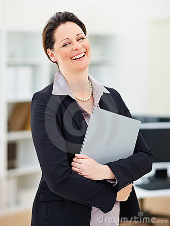 Business woman with a file folder , laughing