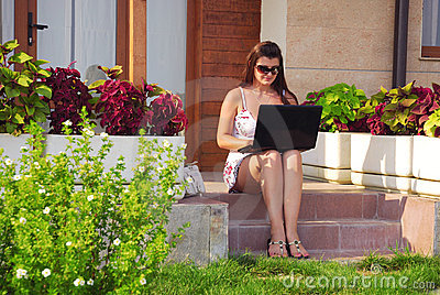 Business woman in front of her house