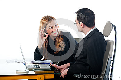 Business woman gesturing OK to colleague at work