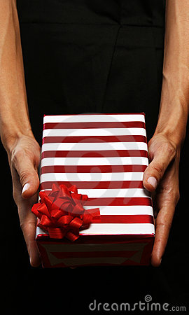 Business woman giving a gift