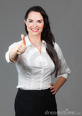 Business woman giving thumbs up