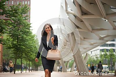 Business woman with handbag walking