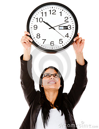 Business woman hanging a clock