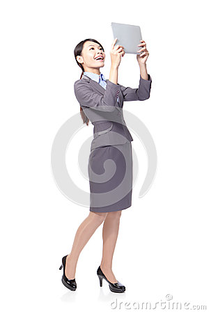 Business woman happy using tablet pc